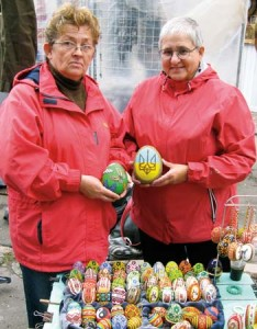 Vira and Maria hold beaded ostrich eggs by Witkowska at the Vernisage in Lviv, 2010